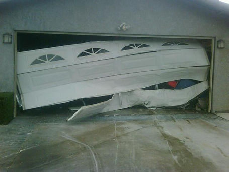 Broken garage door Palm Desert