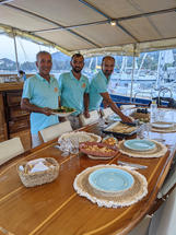 Sailing Chef crew serving dinner