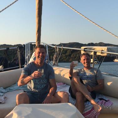 Enjoying a sun down drink on board Saili