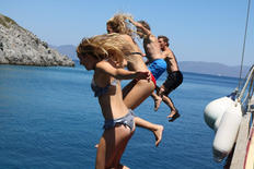 Jumping into the sea from the edge of the gulet