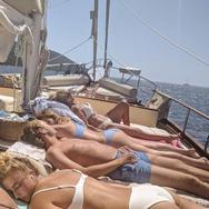 Enjoying the sun while cruising wit Sail