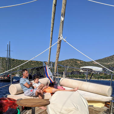 Father and son relaxing on board Sailing