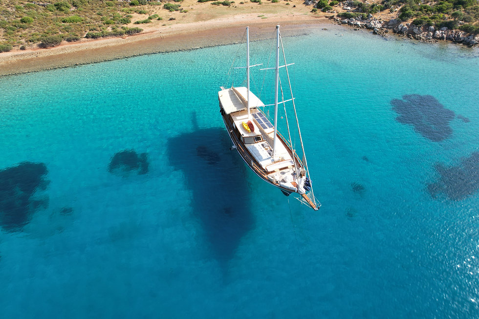 Sailing Chef Exterior - Anchored in turqoise waters.JPG