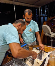 Preparing Fish in Salt Srust at Dining Table