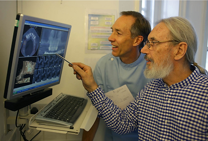 Photo of dentists looking at digital imagery