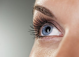 The blue eye of a woman with contact