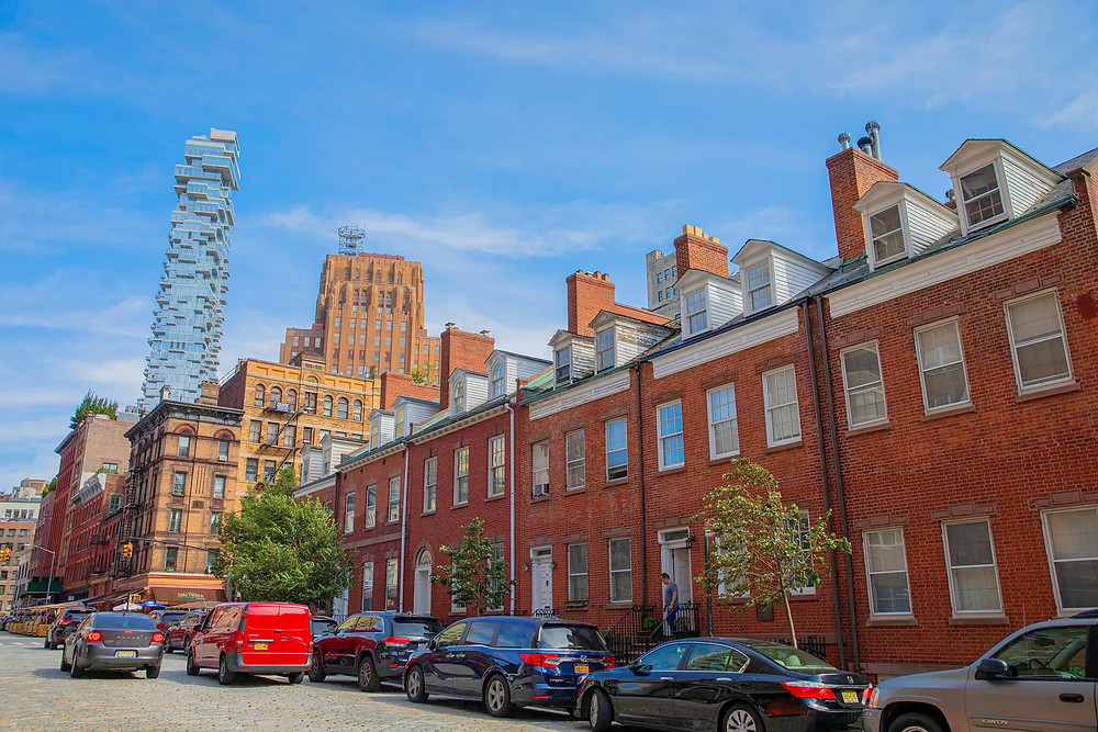 Historic brick townhouses on Harrison Street and the 56 Leonard condominium tower in the background