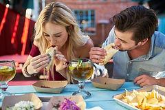 01-couple-eating-tacos.jpg