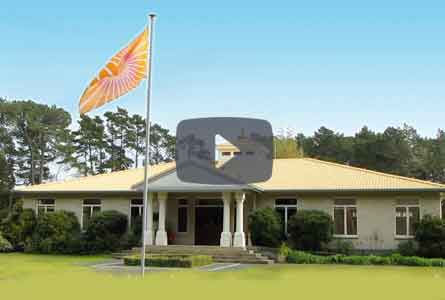 Video Player—Sthapathya Veda Building and flag at Maharishi Spiritual Captal of New Zealand