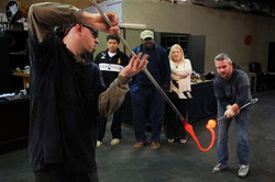 Visitors watch glass blowing
