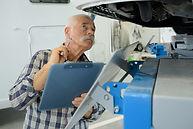 senior man while repairing caravan.jpg