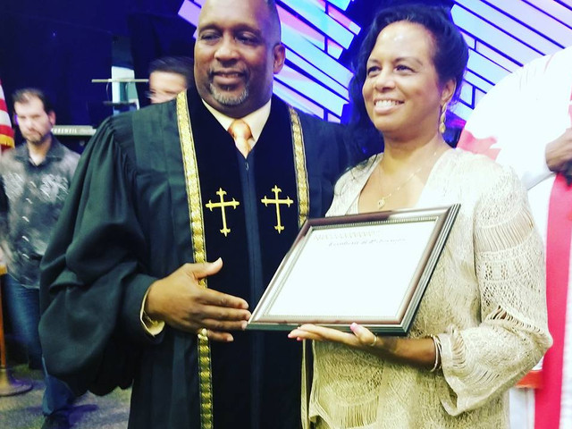 First Lady, Mrs. Bernadette Oliver being promoted to a Paster.