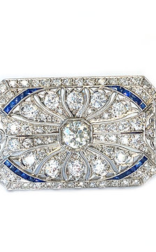 ART DECO PLATINUM DIAMOND AND BLUE SAPPHIRE BROOCH