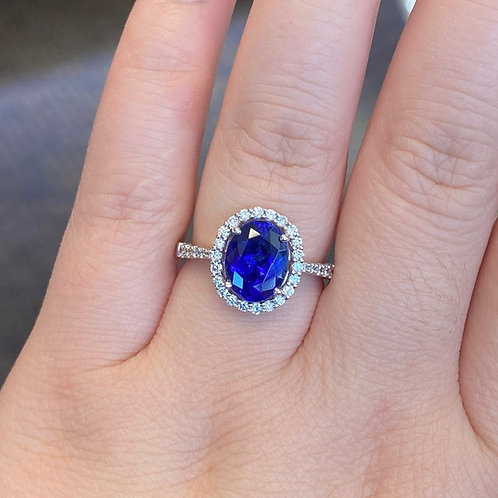 SIMPLE CLASSIC 2.44CT. OVAL TANZANITE & DIAMOND HALO RING