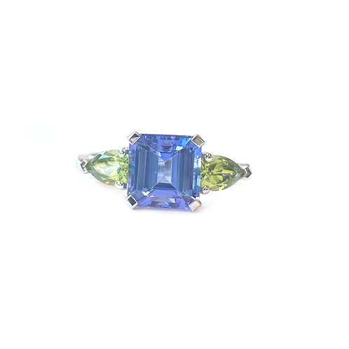 2.30CT. TANZANITE & 1.30CTTW. PERIDOT THREE-STONE RING