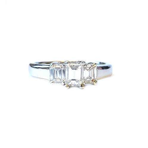 EMERALD CUT DIAMOND THREE STONE RING IN PLATINUM