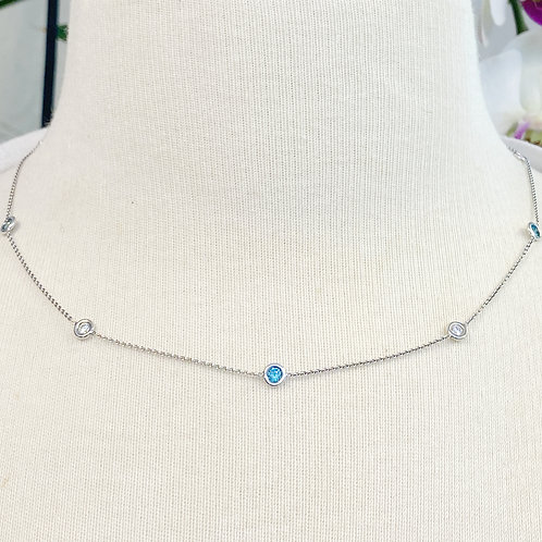 BEZEL STATIONED BLUE AND WHITE DIAMOND NECKLACE IN WHITE GOLD