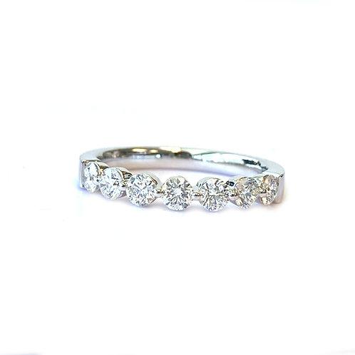 18KTWG 0.73CTTW. SEVEN STONE SHARED-PRONG DIAMOND WEDDING BAND