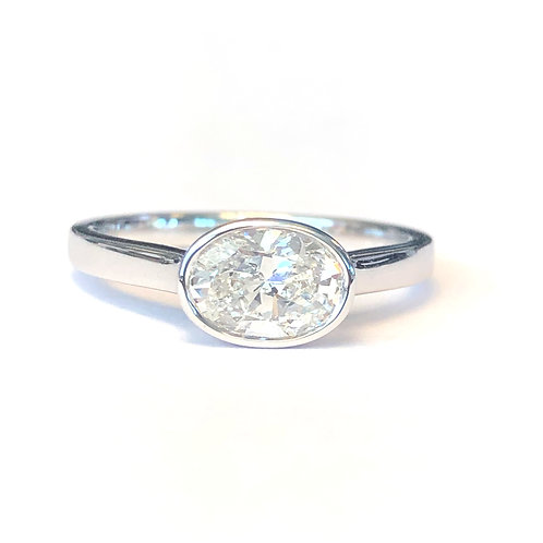 0.89 CT. OVAL BEZEL SET CLASSIC DIAMOND RING
