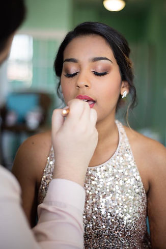 bridesmaid getting her hair and makeup done by the Bridal by OUAB team in Orlando, Florida