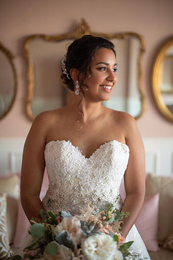 bride on her wedding day after getting hair and makeup done by the Bridal by OUAB team Orlando