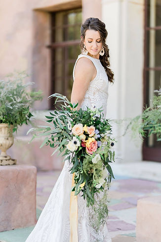 Bride on her wedding day at the Howey Mansion after getting hair and makeup done by the Bridal by OUAB team