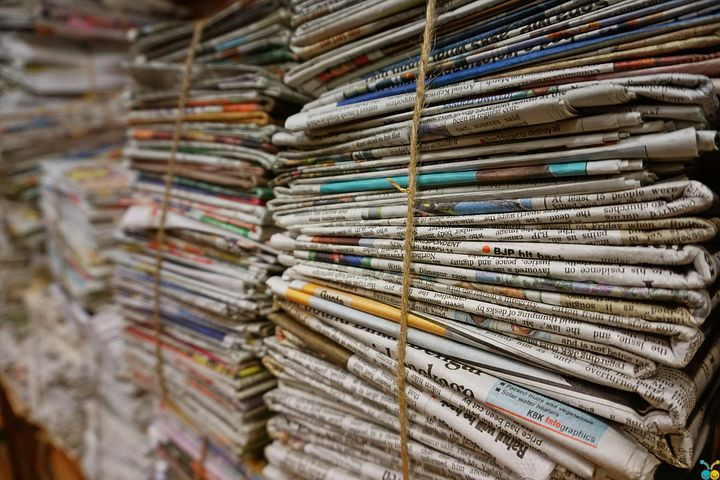 Newspapers bundled from Pixabay in Your Family Genealogist blog post