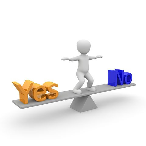 Picture of person on a see-saw balancing between Yes and No - courtesy of Pixabay.com