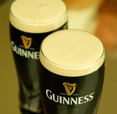 Photo of 2 glasses of Guinness in blog about Guinness Brewery personnel records - from Pixabay