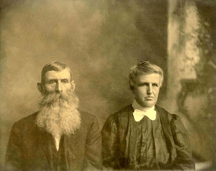 Old photo of elderly couple c.1910 in blog about Irish pension records by Your Family Genealogist