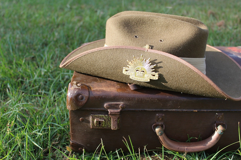 Digger's hat and old brief case picture for Your Family Genealogist Blog about WW1 Embarkation Rolls