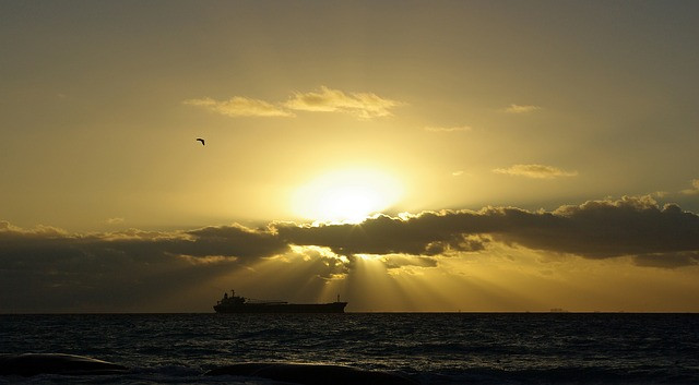 Picture of cargo ship in the setting sun from Pixabay.com