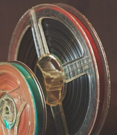 Coloured picture of two old film reels - courtesy of www.pixabay.com