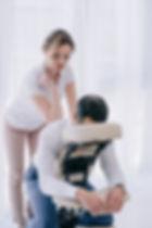 professional masseuse doing seated back