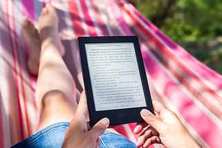 Photo of a person holding an ebook reader