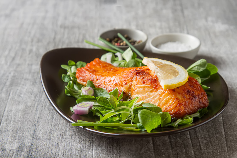 One piece of baked salmon grilled pepper
