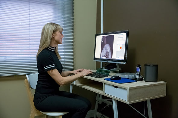 Dr Janine analysing X-rays at House of Chiropractic