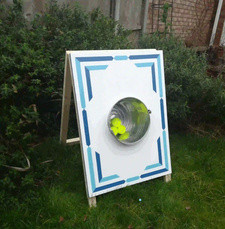 ball in a bucket on lawn garden game