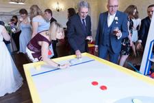people playign shuffle board