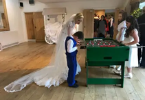 bride and children playing tablefootball hire wedding