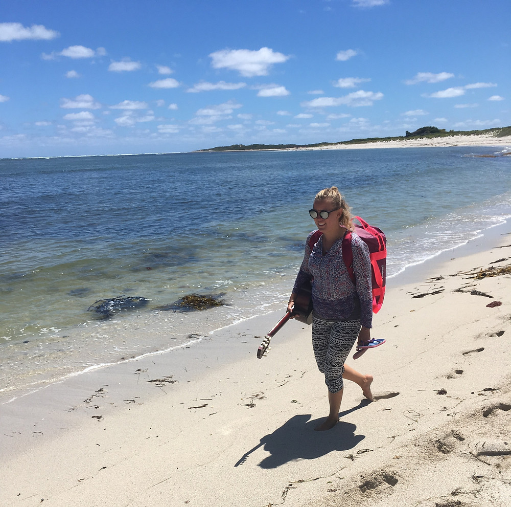 Tour Leader Kati Pankka walking on a beach in South Australia
