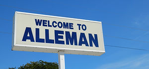 Iconic Welcome to Alleman Sign. Sign is displayed at the Heartland Co-op Service Station.