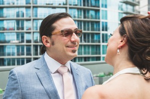Groom smiles during first look