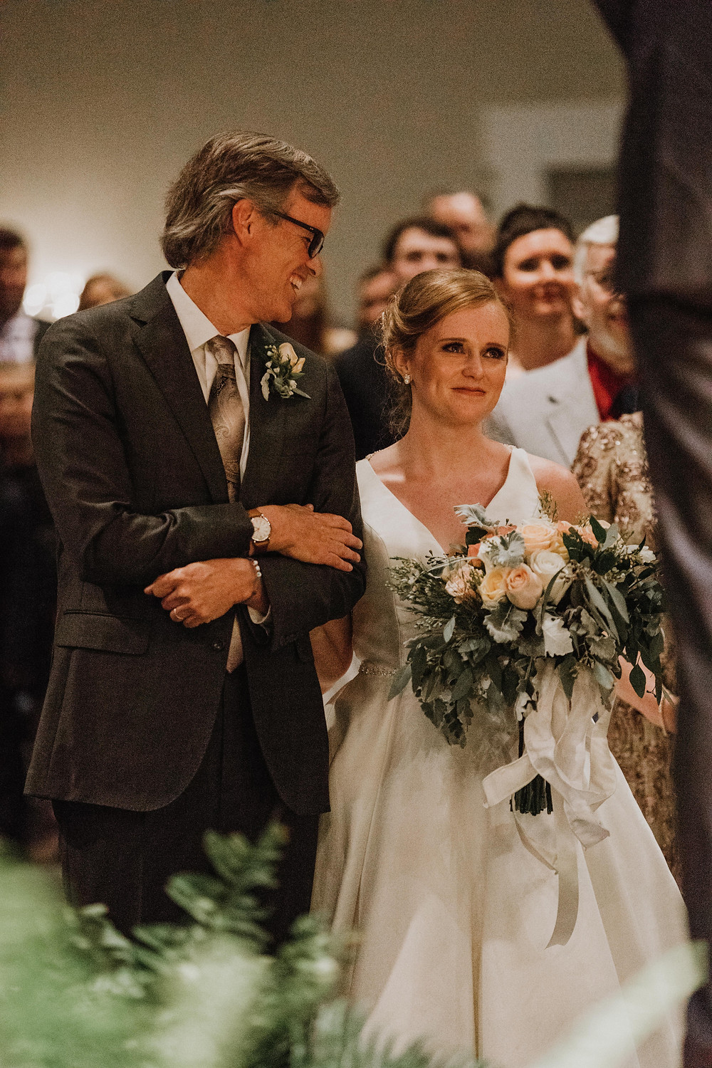 father smiles at bride
