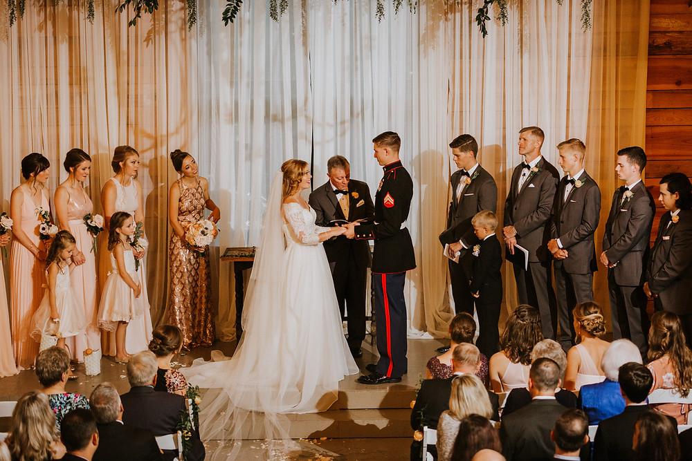 groom put ring on bride