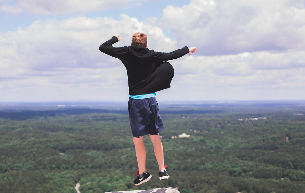 Jumping on top of Stone Mountain