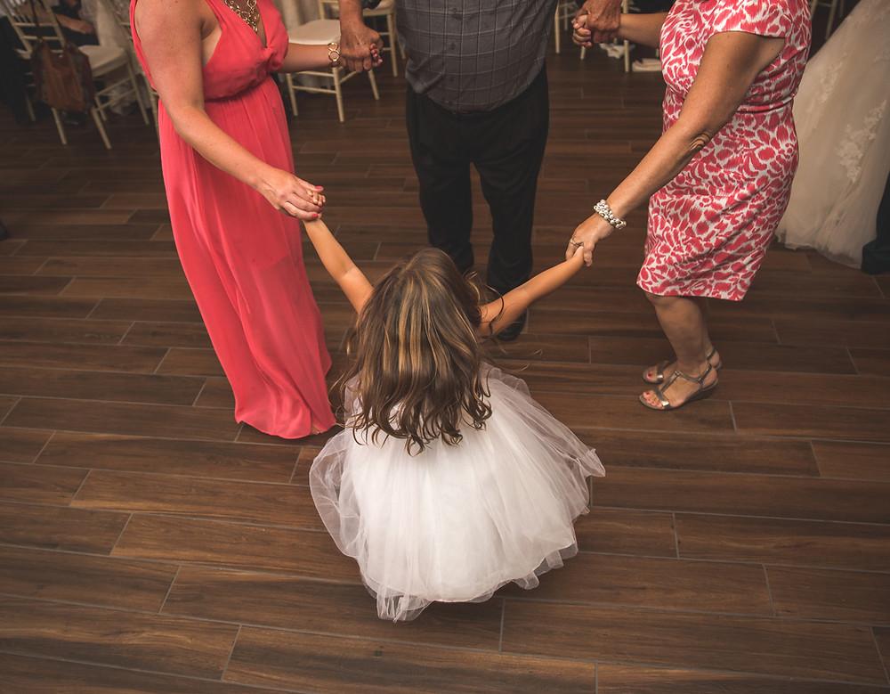 Flower girl dancing at wedding