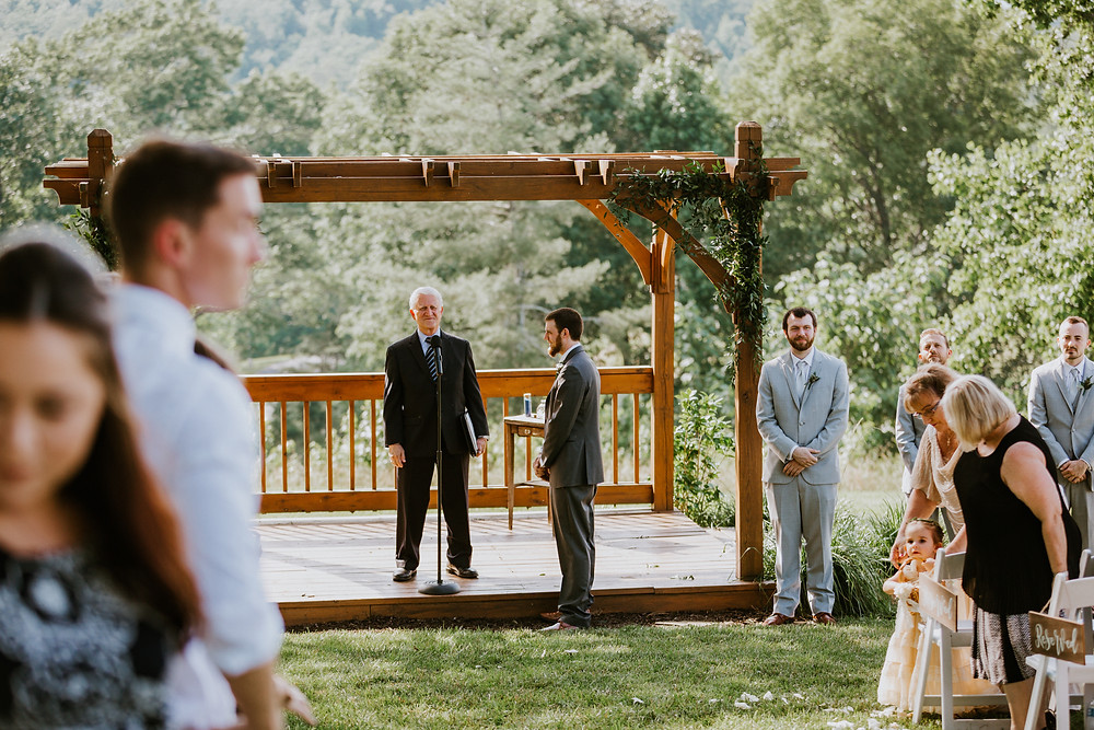 groom waits for bride at alter