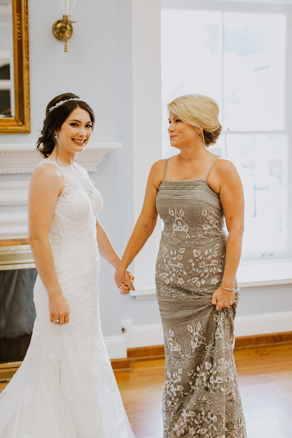bride holds mother's hand