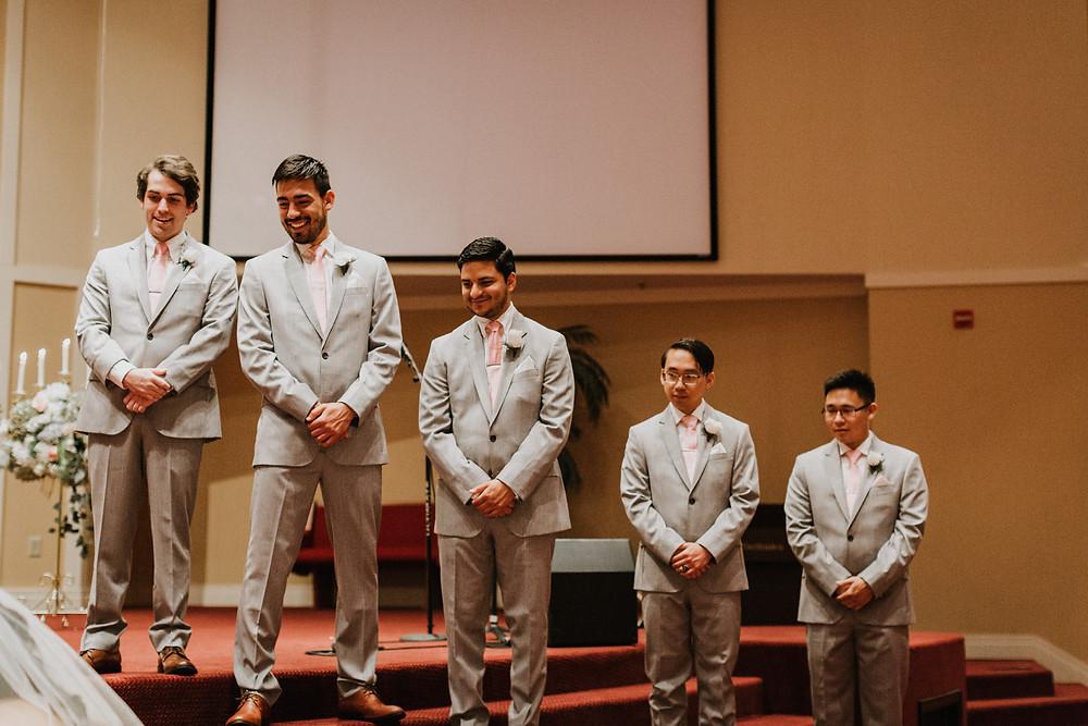 groomsmen watch ceremony
